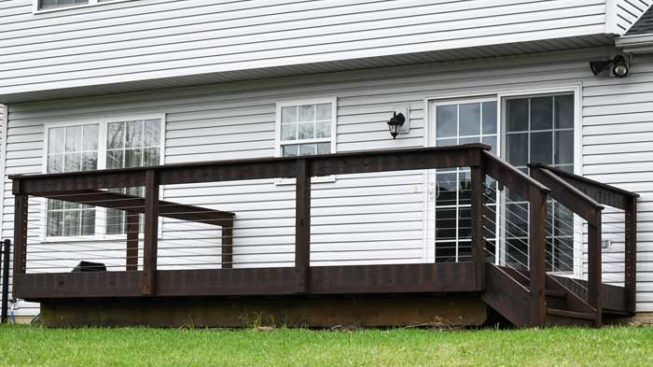 Cable railing deck remodel with wood posts